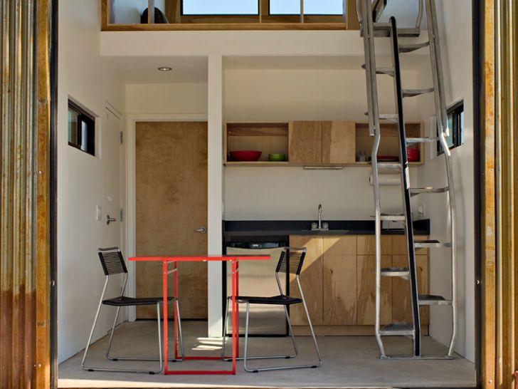 Открытая кухня первого этажа. На второй этаж ведет компактная лестница.  (маленький дом,архитектура,дизайн,экстерьер,интерьер,дизайн интерьера,мебель,минимализм,индустриальный,лофт,винтаж,стиль лофт,индустриальный стиль,кухня,дизайн кухни,интерьер кухни,кухонная мебель,мебель для кухни,спальня,дизайн спальни,интерьер спальни) .