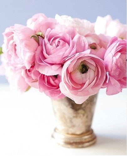 Gorgeous flowers in gold vase for decor