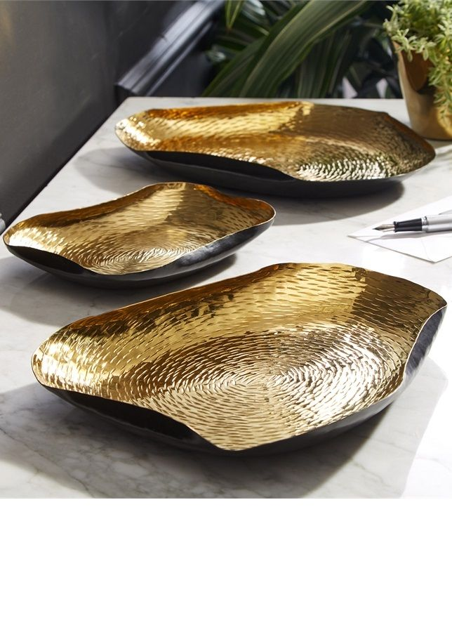 Gold + Black decorative trays. Link gives you access to even more gold home accessories