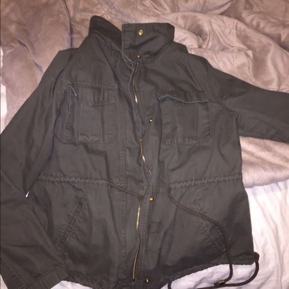 Old navy utility coat  It's olive colored, not faded and not damaged or mistreated at all, got this on April and it's been used about 10 times so it hasn't lost its color over washes. Has a lot of life  offers are welcomed  Old Navy Jackets & Coats Utility Jackets
