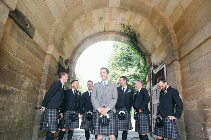 The groom and groomsmen wear traditional kilts for a Scottish wedding | Photography by http://www.mirrorboxphotography.com/