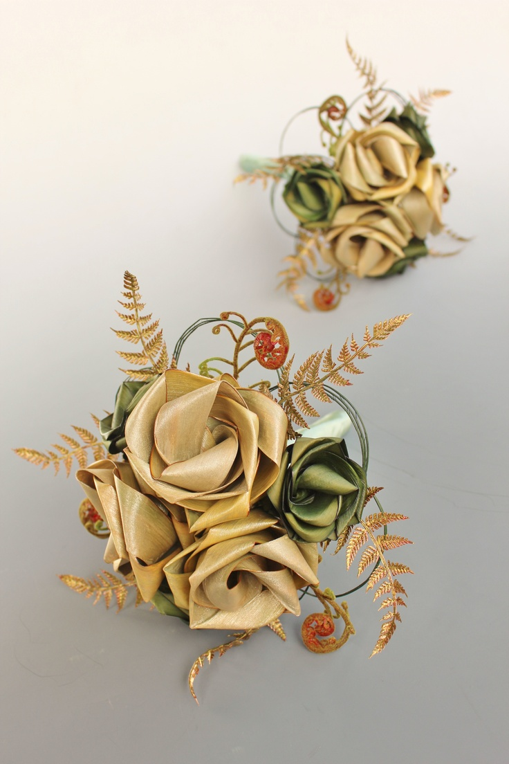 Six flower bridesmaid bouquets with gold fern and koru.  www.flaxation.co.nz