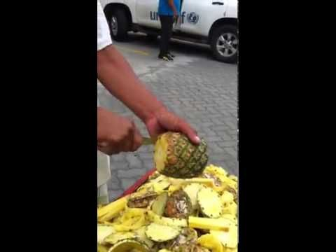 And he does it in just 50 seconds... | You've Been Cutting Pineapples The Wrong Way Your Whole Life
