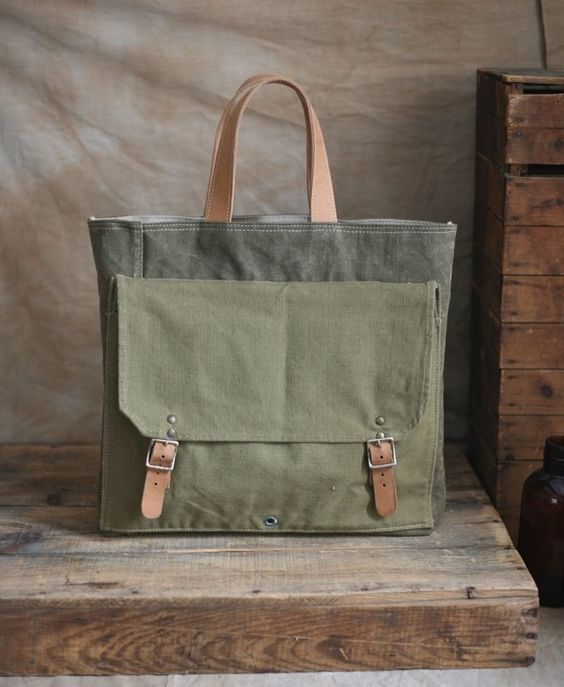 Forestbound | Recycled Canvas Tote Bag  Sturdy, worn-in canvas salvaged from a WWII era military duffel bag has been paired with a large canvas pocket taken from a 1950' era hiking pack and transformed into a sturdy everyday carryall.