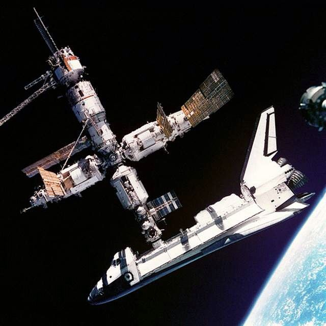 This view of the Space Shuttle Atlantis still connected to Russia's Mir Space Station was photographed by the Mir-19 crew on July 4, 1995. Cosmonauts Anatoliy Y. Solovyev and Nikolai M. Budarin, Mir-19 Commander and Flight Engineer, respectively, temporarily undocked the Soyuz spacecraft from the cluster of Mir elements to perform a brief fly-around