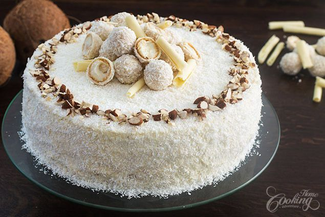 Delicate and elegant Almond Coconut Cake made with an almond sponge cake, a white chocolate, mascarpone and coconut filling and topped with Raffaello Truffles, chopped almonds, chocolate curls and shredded coconut. full recipe… Facebook Google+ Pinterest Twitter