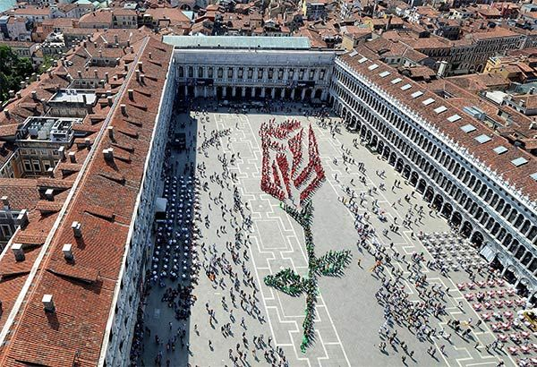 """Over one thousand residents of Venice participate in composing this living rosebud in St. Mark square in Venice, on occasion of the """"Festa del Bocolo"""", a tradition dating back to the Middle Age."""