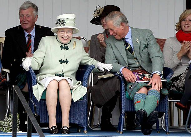 Queen Elizabeth II and Prince Charles, Prince of Wales laugh as they watch the tug-of-war during the Braemar Highland Games at The Princess Royal and Duke of Fife Memorial Park on September 4, 2010 in Braemar, Scotland. The Braemar Gathering is the most famous of the Highland Games and is known worldwide. Each year thousands of visitors descend on this small Scottish village on the first Saturday in September to watch one of the more colourful Scottish traditions. The Gathering has a long…