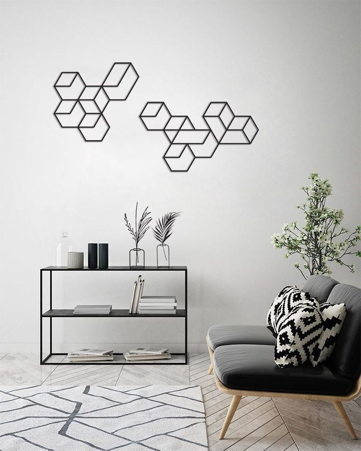 An x-large black metal wall art featuring a geometric pattern