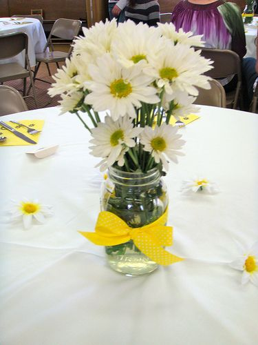 Mason jar filled with daisies hand picked by me from a field out back...will be put on my kitchen counter everyday...something about daisies brightens my day
