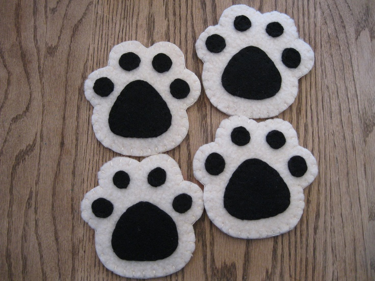 paw print felted wool coasters....GO DAWGS!!  I am making these in red and black :)