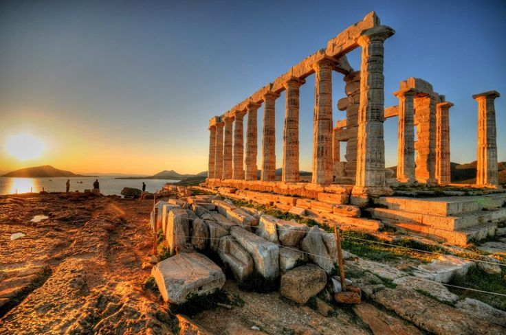 During this period, they would built temples for the Gods, not just Athena.  The sun setting at Cape Sounion over the ancient Greek Temple of Poseidon