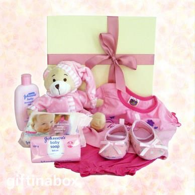"""Perfect for the new little bundle of joy. A selection of """"cute"""" pink baby clothes and bath products for the new born baby girl!   Cute pyjama teddy bear Johnson's baby moisturising lotion Johnson's baby wipes Johnson's baby soap little """"fairy"""" booties Cutie Pie outfit - T-shirt and pants"""