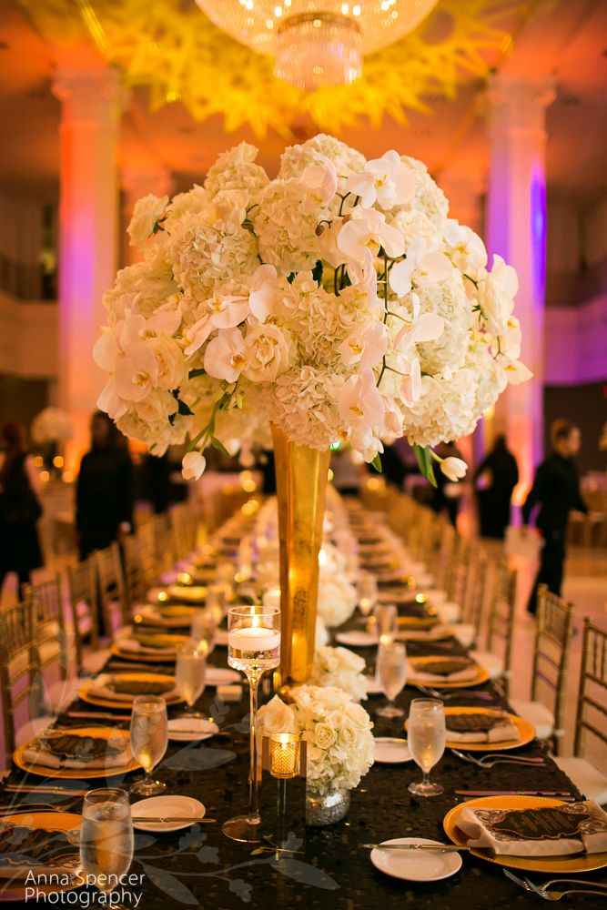 intimate wedding packages atlantga%0A     and phalaenopsis orchid floral arrangement on an estate table  Black  sequin table linen with gold chargers  F  u     G Weddings  Edge Design Group  Florist