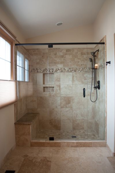 colorado springs bathroom remodel with travertine tile moen handheld shower bench and builtin shelf in colorado springs