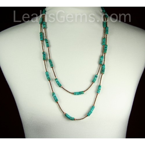 """This turquoise necklace is 60"""" long, lariat style and is made to be worn 2 or 3 times around your neck. There is no clasp and it is easy to take on and off. The accent metal I have used is copper and with the brown seed beads it really sets the turquoise off nicely. $89.00"""