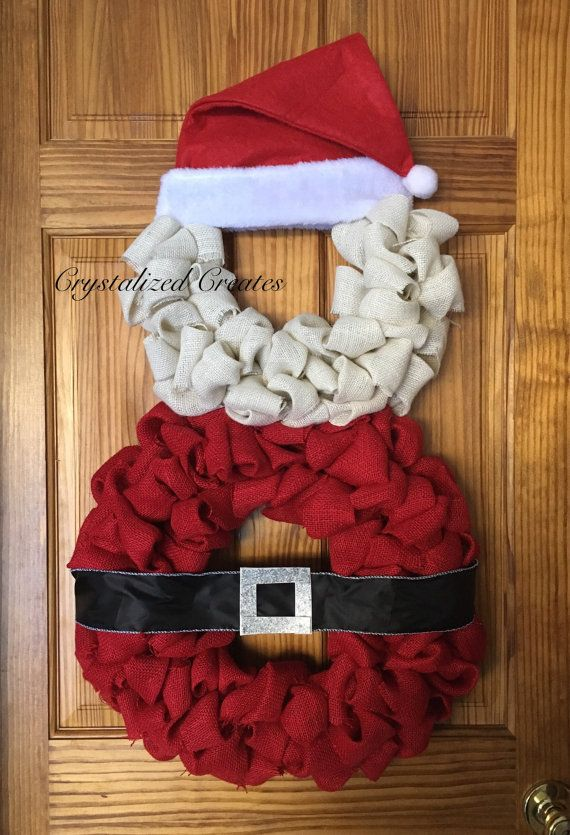 Burlap Santa Claus wreath with felt hat. Hang this adorable one of a kind Santa wreath on your covered front door or inside this Christmas! -Wreath is approximately 33 inches tall with hat and approximately 18 inches wide. -Ready to ship in 3-5 business days Note: This wreath is not meant for direct outside elements such as rain or snow. If hanging on an outside door, hang on doors that are covered with roofs or awnings or inside a glass screen door. Direct sunlight may also change the...