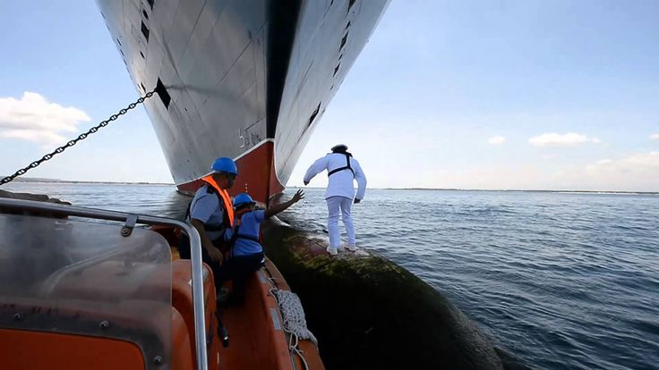Behind the scenes: Queen Mary 2 Captain photographed on the bulbous bow