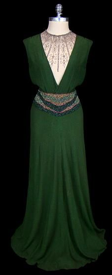 Beautiful green 1930s dress via The Frock...with V-plunge neckline, decorated waist and floor sweeping length...