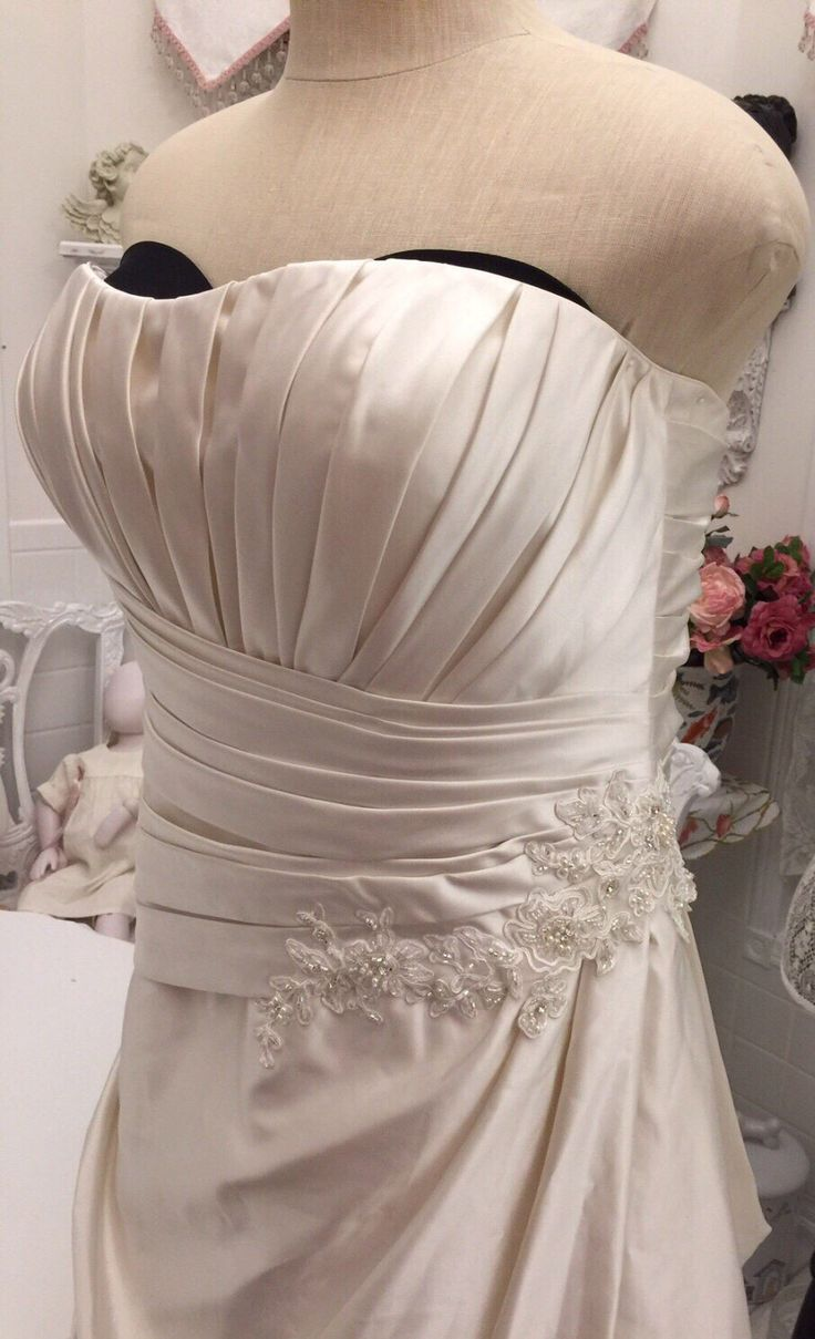 A personal favorite from my Etsy shop https://www.etsy.com/ca/listing/509868417/size-22-beach-wedding-dress-ivory-satin