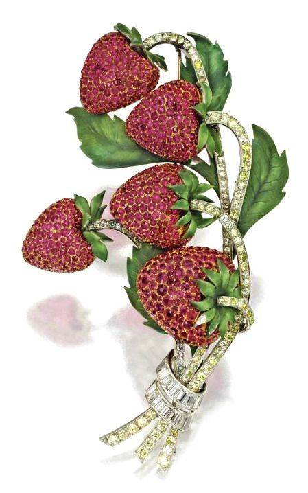 Ruby, green enamel and diamond strawberry brooch, Circa 1940 ~ Round, single-cut and baguette diamonds weighing a total of approximately 5.00 carats, mounted in gold and platinum.