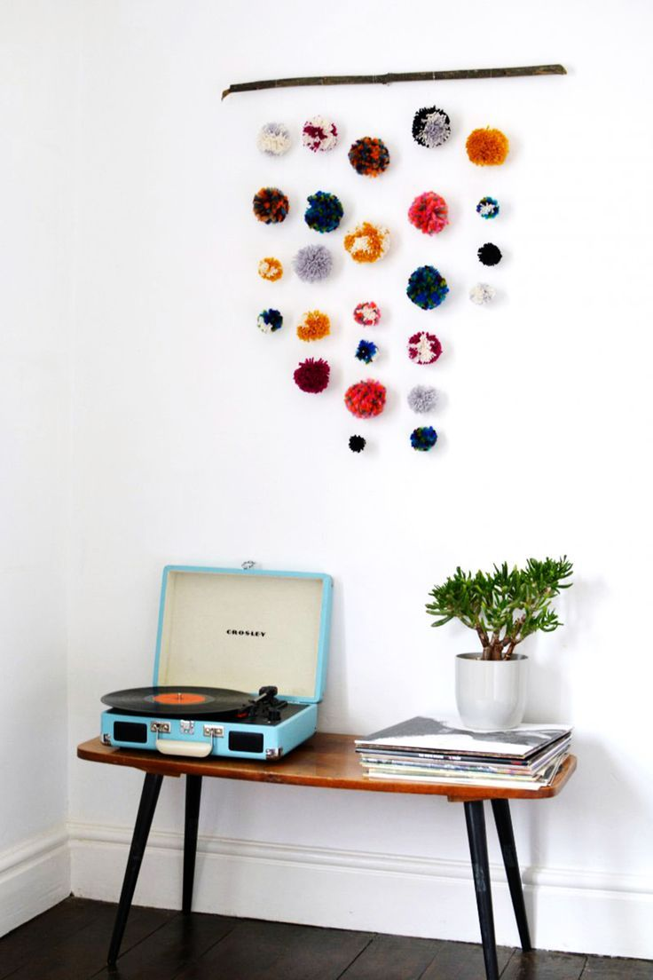 A cheap, easy, creative idea to decorate your dorm room with pompoms!