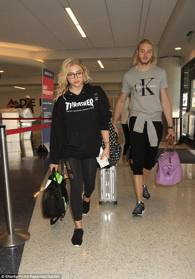 Holding him close: Despite Chloe Grace Moretz's departure from her boyfriend Brooklyn Beckham's side, she found a way to stay close to him as she sported his hoodie while heading to LAX airport on Sunday