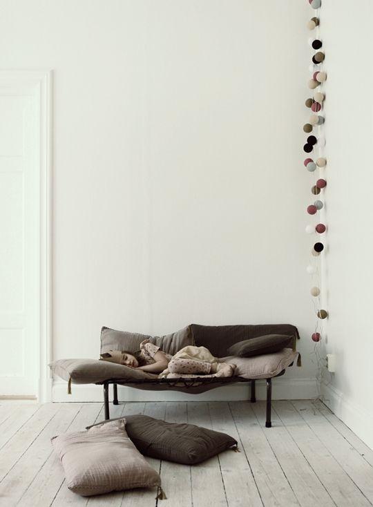 I keep seeing wood floors painted white everywhere...I am liking them. Cold/mountainy/eastern European feeling