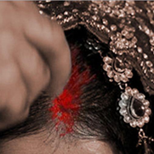 Sindoor Ceremony - The groom applies a streak of vermillion on the