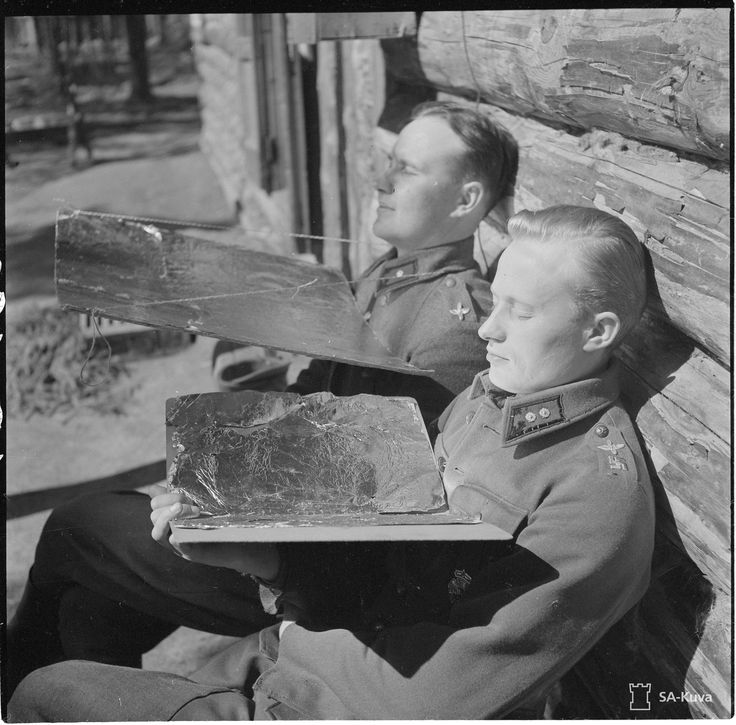 Finnish air force officers sunbathing during World War 2 (1943)