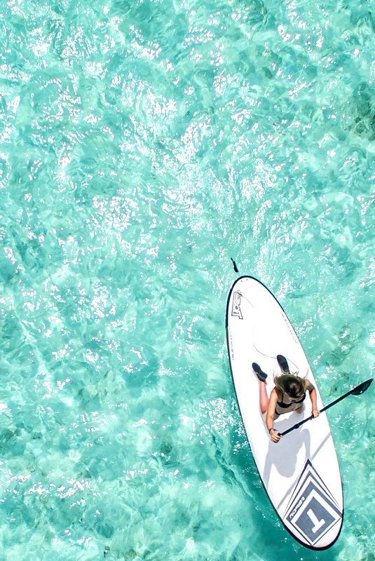Paddleboarding in the Maldives. Bliss! Click through for tips.