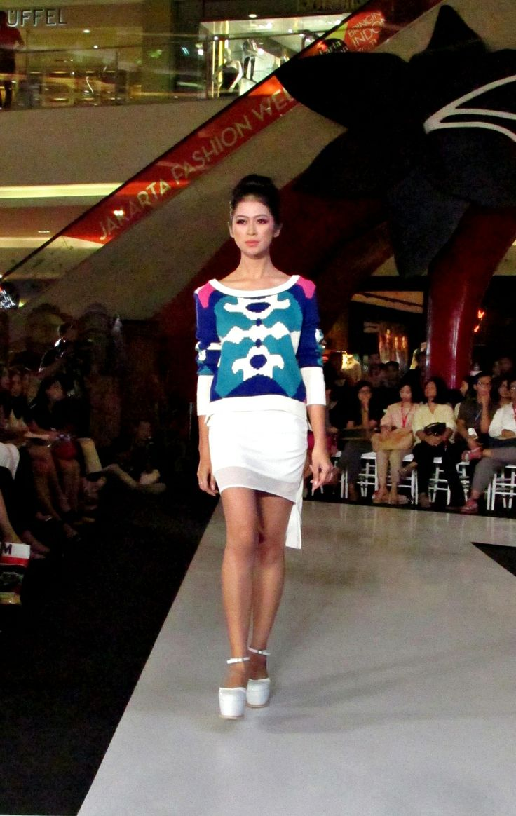 Signature jumper and sporty inspired skirt