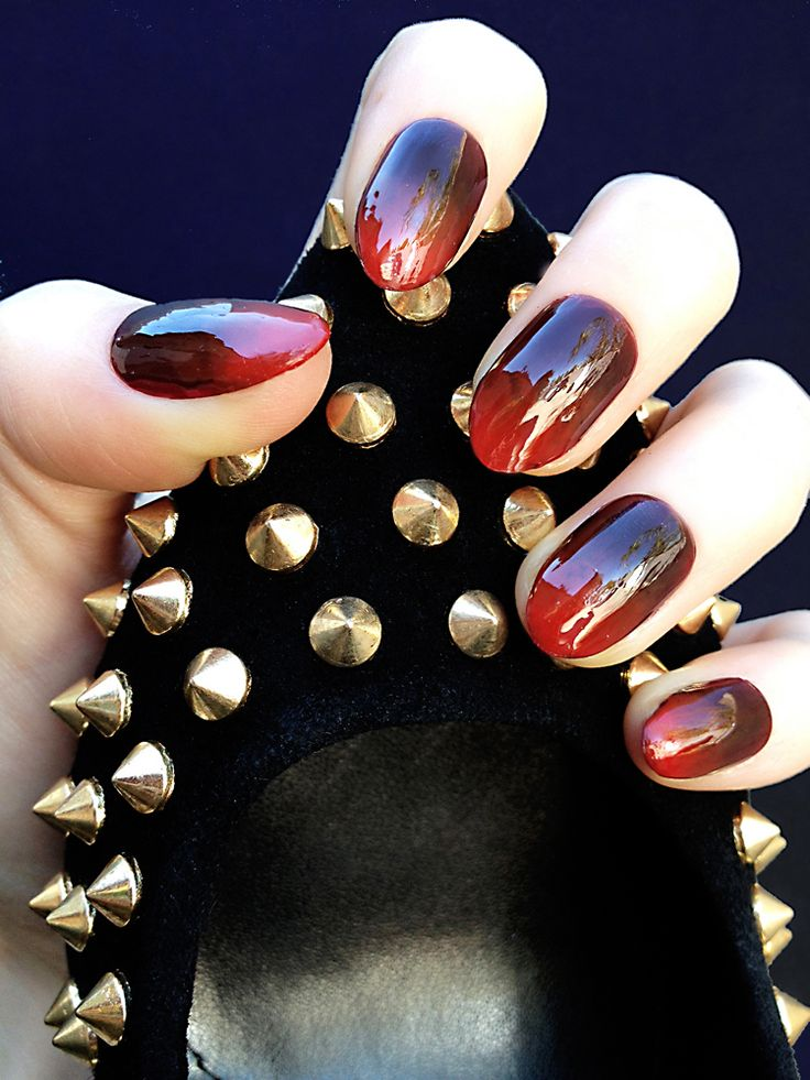 Nails by Stephanie Stone for Steve Madden. Oxblood Gradient nail holding the Intrud-S shoe.