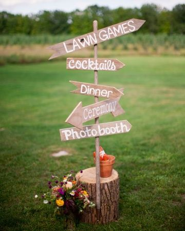 wood sign directed guests to various wedding activities / http://www.deerpearlflowers.com/tree-stumps-wedding-ideas-for-rustic-country-weddings/2/