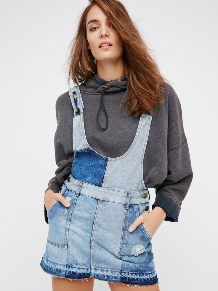 Patchwork Blues One Piece Mini   Ultra cool denim one piece mini featuring a light and dark denim patchwork design with distressing and an undone hem for a lived-in look. Adjustable straps and side button closures for the perfect fit. Belt loops at the waist. Four pocket design.