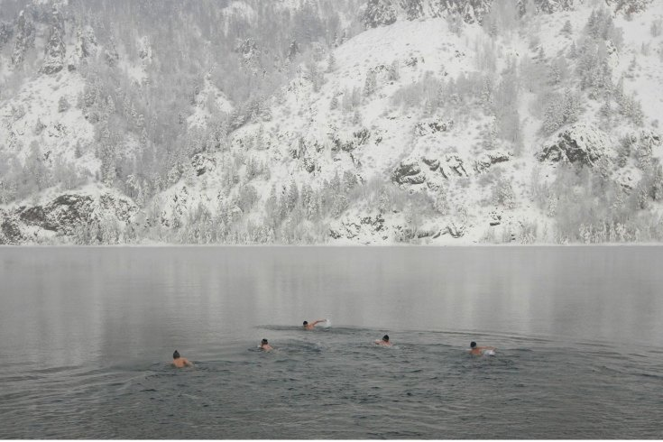 Jan. 11, 2013. Members of a local winter swimming club take part in their weekly bath in the Yenisei River, while air temperatures stand at minus 17 degrees Celsius (1.4 degrees Fahrenheit), in the town of Divnogorsk, outside Russia's Siberian city of Krasnoyarsk.