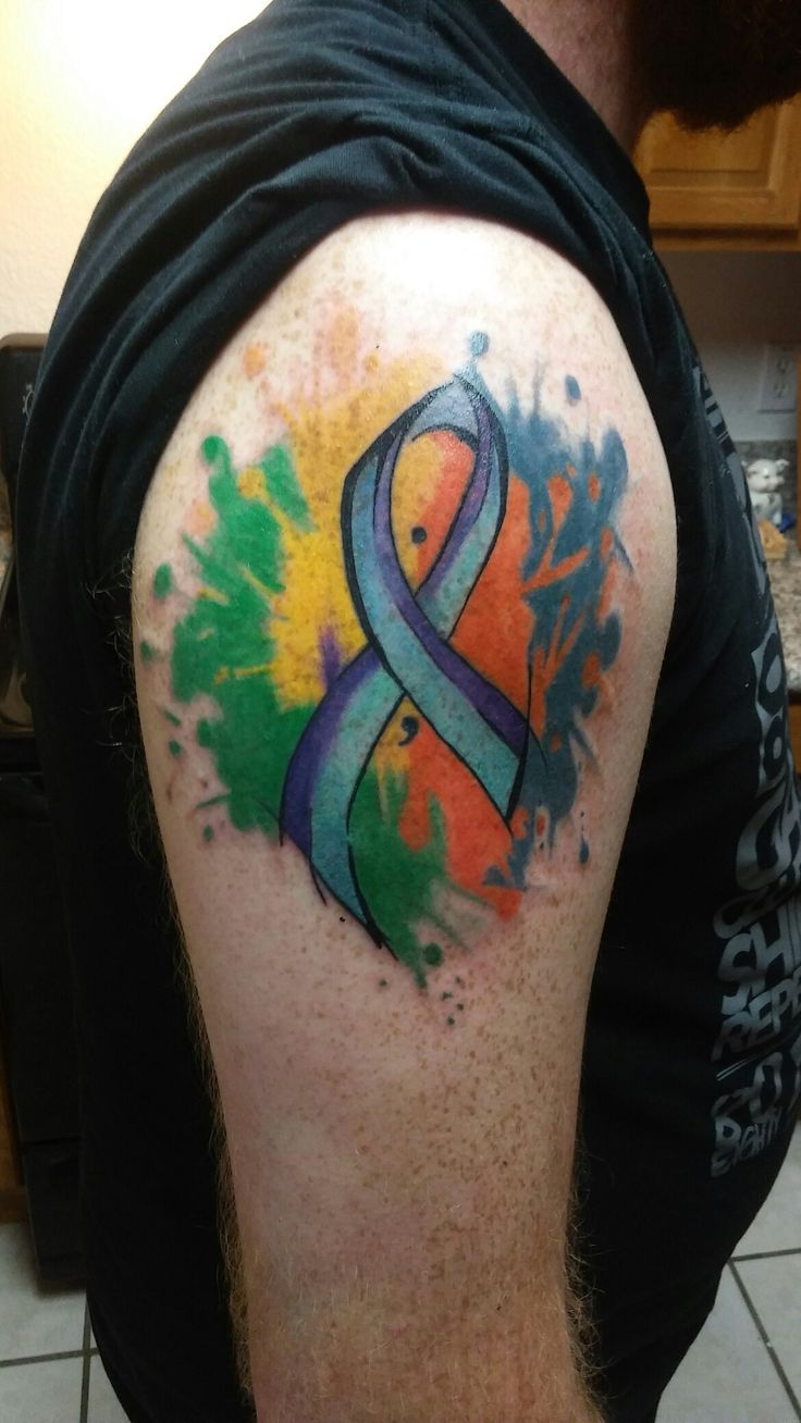 My first tattoo #watercolor #suicideawareness #ribbon #semicolon #colorsplater #green #yellow #purple #blue #orange #teal