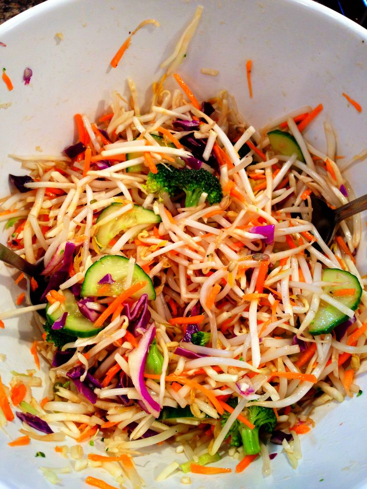Asian Slaw  1 bag of Rainbow Coleslaw can use  the broccoli shred (or 1/2 cup of florets) if you like 1/2 bag of Bean Sprouts 1 cup sliced cucumber 2 Tsp Sesame Oil (olive oil if allergic) 1 Tsp Fish Sauce 2 Tbs Rice Wine Vinegar 1 Tsp brown Sugar, agave or palm 1-2 Tbs Braggs Soy 1 Tbs Lime Juice 3 Cloves of Garlic, minced Salt, pepper    (Again, add more of which ever for taste) Toss together, Refrigerate for at least an hr.