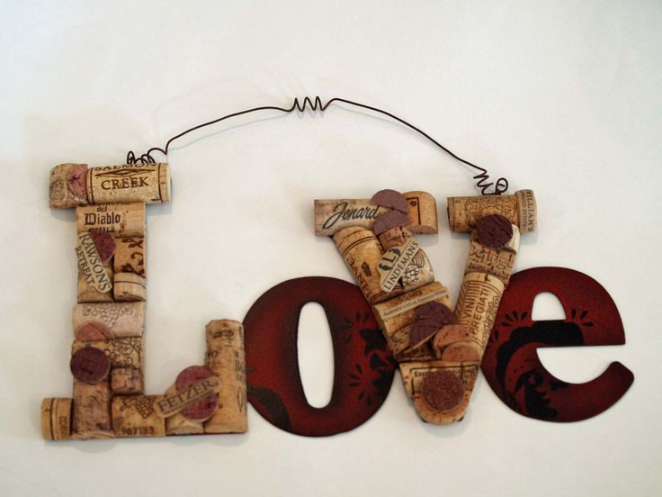 "For the kitchen // ""Love"" sign made from upcycled wine corks."