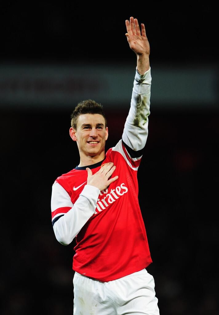 Koscielny Salutes the Fans After Victory vs Liverpool in the FA Cup 2013-2014.