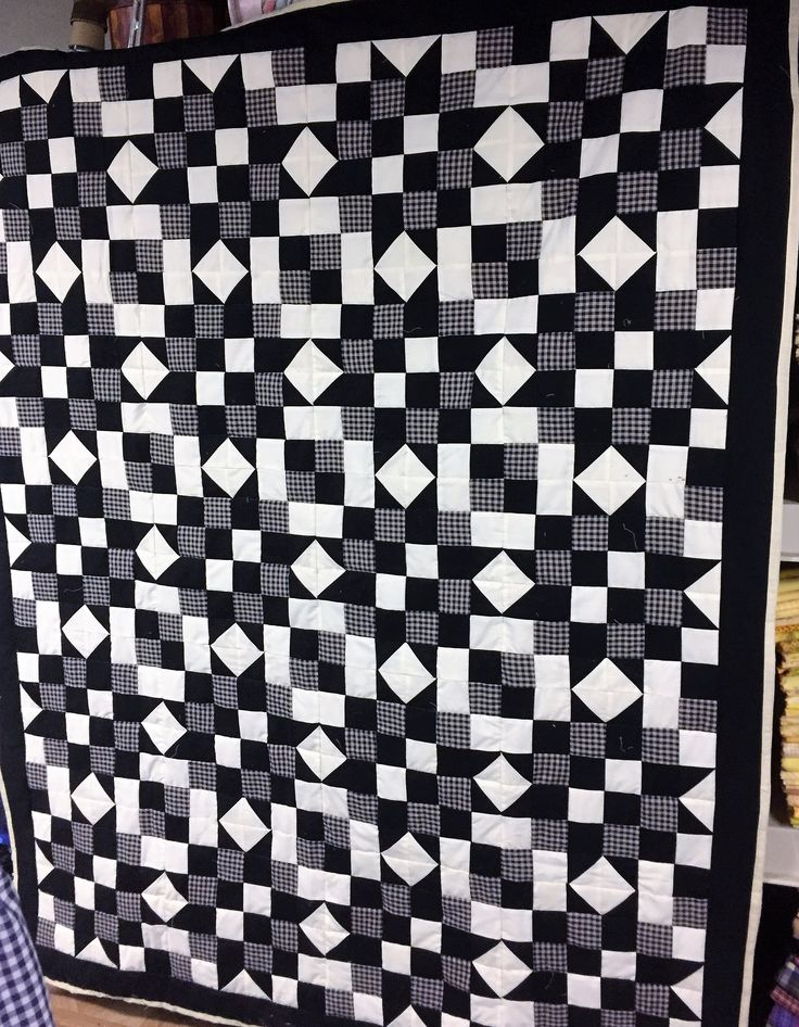 Black and cream homespun, large wall hanging quilt.