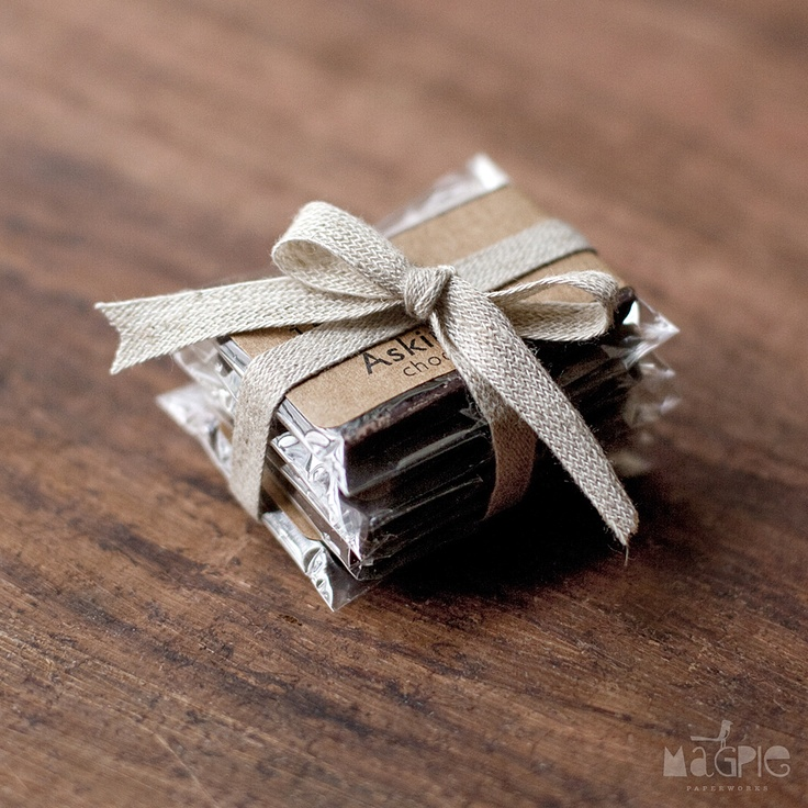 Favors: Ghirardelli chocolate squares, tie with gold ribbon - mint, cabernet, sea salt caramel, and so many other great flavors!