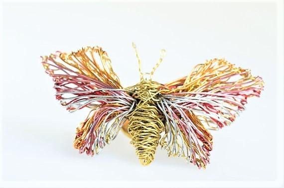 Butterfly brooch, wire butterfly jewelry, gold pink, tiny sculpture, insect art, romantic gift for her, dance teacher gift, cute pin, hippie  Handmade wire art, butterfly brooch pin, made of colored copper and silver wire. The height of the gold pink, tiny sculpture, romantic gift for her, hippie, insect art jewelry is 2cm (0.79in), and the width (body with wings), of the cute pin, dance teacher gift, is 4cm (1.57in).The pin is bronze.