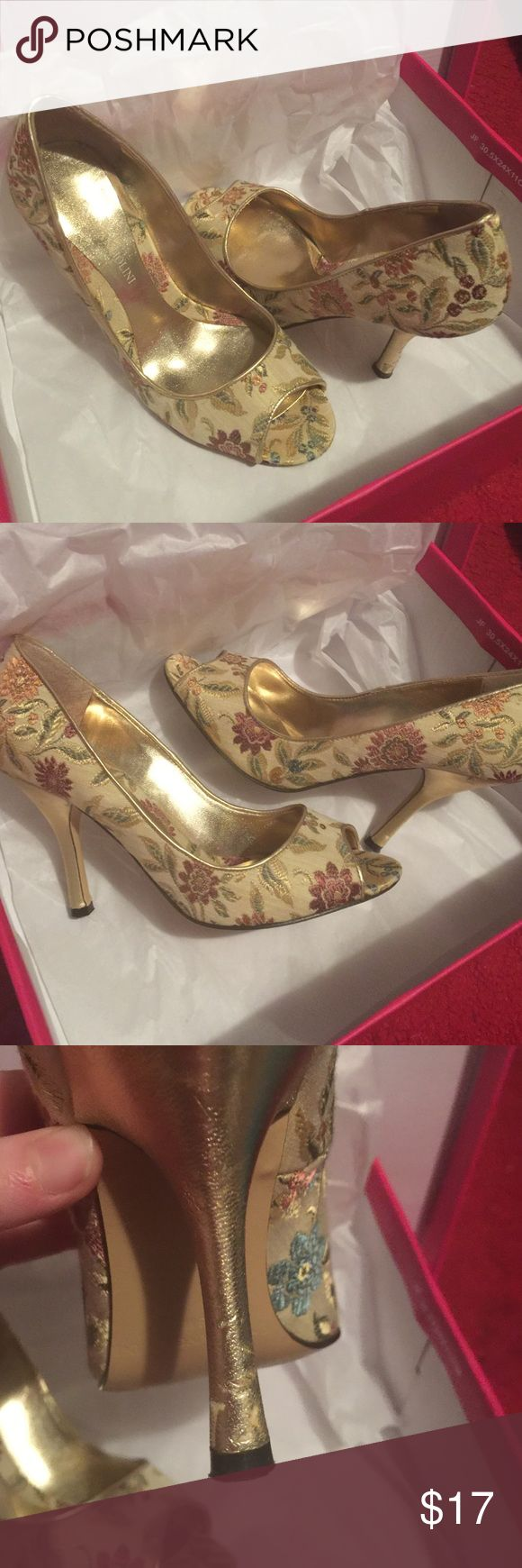Gold peep toe heels with floral detailing!! Beautiful 3 1/2 inch heels!! Gold with shimmery floral details!! Only wore a couple of times!! Beautiful shoes!! Enzo Angiolini Shoes Heels