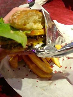 Eat Drink And Be Me: My husband and I ate at Red Robin on Veteran's Day and shared the Tavern Double Burger and Bottomless Fries they offered for free to veterans that day.  Really good!