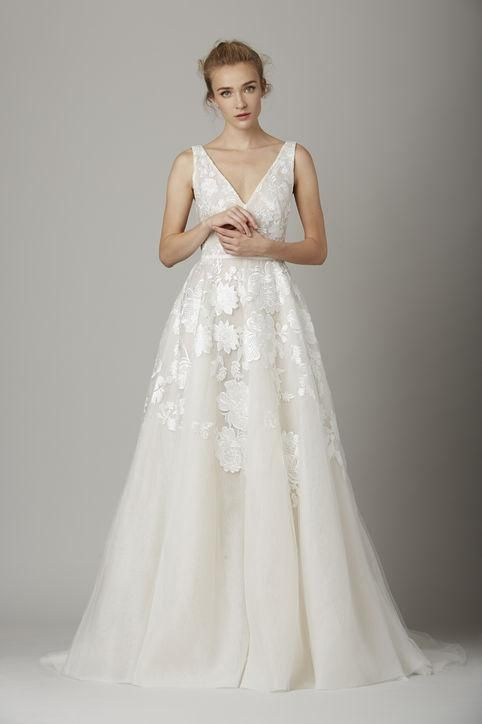 How pretty is this sleeveless Lela Rose wedding gown? Click for more we love