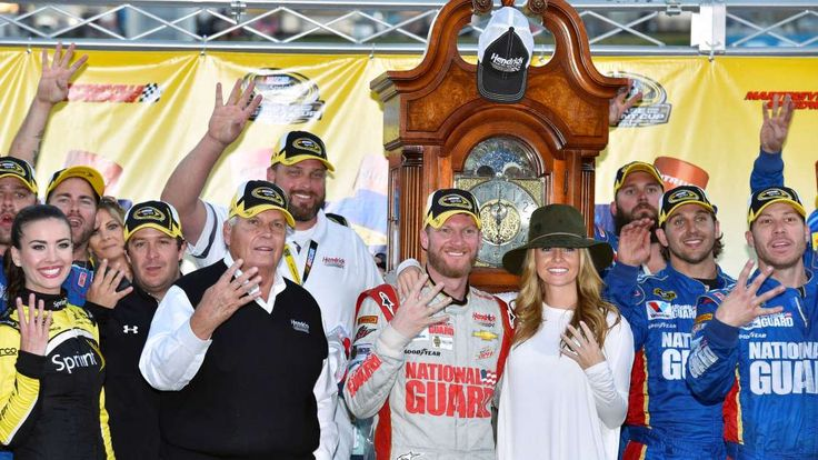Looking back on Dale Earnhardt Jr.'s 26 career wins  -  April 26, 2017:      MARTINSVILLE SPEEDWAY, OCTOBER 2014  -    Joined by team owner Rick Hendrick (left) and wife Amy (right) Earnhardt celebrates winning his first grandfather clock in the fall race at Martinsville.