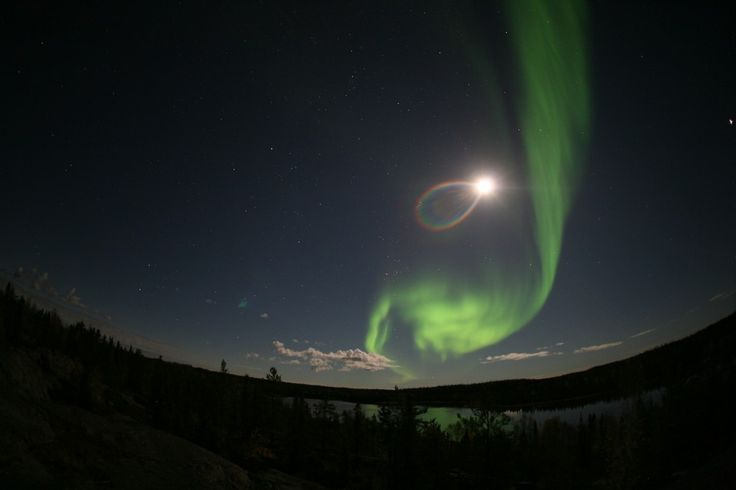 Rainbow ring around the moon shines with an aurora over Yellowknife, Canada