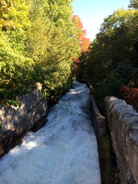 Buttermilk Falls, once a busy log chute, is now a popular place for hikers to enjoy landscape and photography.