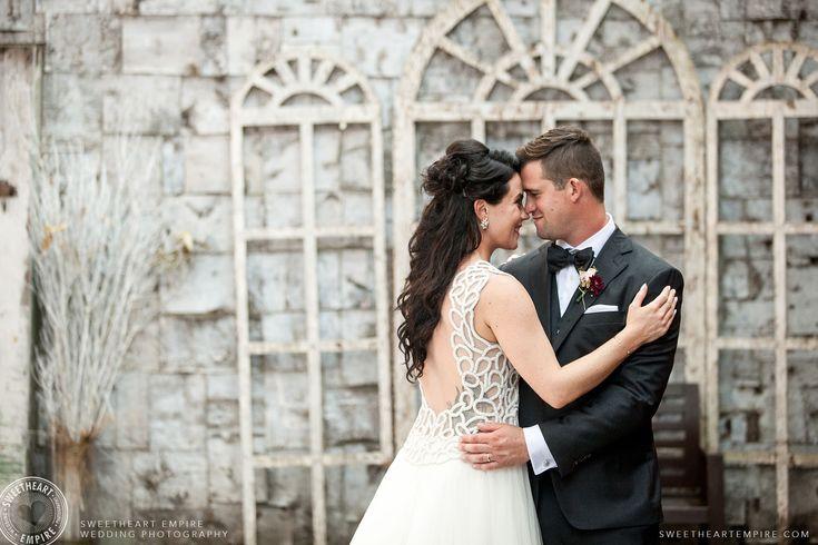 Lelania & Mike sharing a moment as newlyweds in the Berkeley Church courtyard. Toronto wedding photographer #sweetheartempirephotography